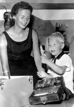 This picture from July 1959 shows Mary (Maxwell) Gates and her 3 1/2-year-old son, Bill, in a picture that first appeared on the pages of the Seattle Post-Intelligencer. Mary Gates was then chair of a Junior League project that had Junior League members visiting grade school classrooms with Museum of History and Industry artifacts, which is what the younger Gates is playing with here. The print, with marks from a photo editor, remained in the P-I collection, but the negative was donated to the Museum of History and Industry in 1976, a year after Bill Gates founded Microsoft. (MOHAI/Seattle Post-Intelligencer Collection/seattlepi.com file)