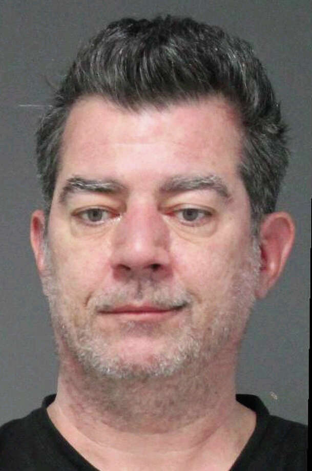 In this Feb. 20, 2013 photo provided by the Clarkstown, N.Y. Police Department, Lawrence Mulqueen is shown. Mulqueen, 49, of Nanuet, N.Y., was arraigned Thursday, Feb. 21, on charges of making terroristic threats, illegally possessing weapons and harassment. Authorities say that he has made threats on Facebook against a collection of politicians that included New York Governor Andrew Cuomo, members of Congress and President Barack Obama. Investigators also found two rifles, bayonets, ammunition, body armor, a sword and a knuckle knife: all illegal because Mulqueen is a convicted felon. (AP Photo/Clarkstown Police Department)
