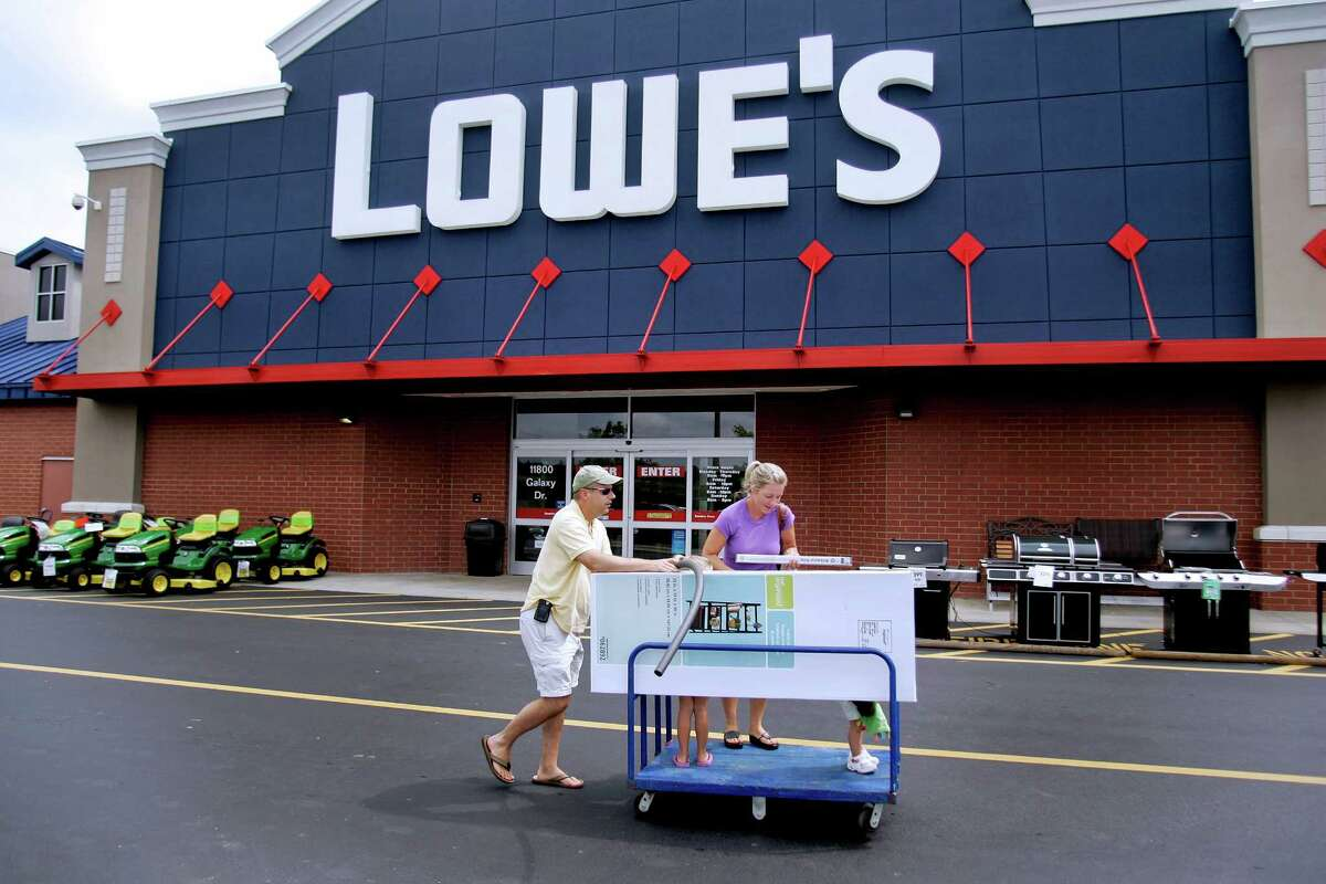 In this file photo, customers leave a Lowe's store with their purchases in Wake Forest, North Carolina. Lowe's Cos. is the second-largest U.S. home improvement retailer.