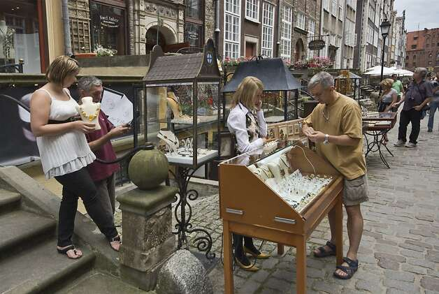 Shoppers check out jewelry for sale on the streets of Gdansk, Poland. Photo: Witold Skrypczak, Lonely Planet Images