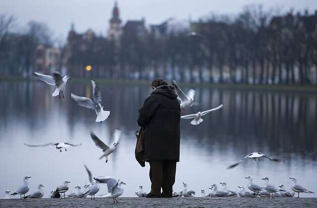 A woman feeds seagulls in Schwerin, the capital of the German state of Mecklenburg. Photo: Ens Buttner, AFP/Getty Images