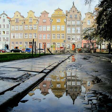 In Gdansk's Old Town, a typical row of pastel-colored houses glistens in the morning sun after a rainy night. Photo: Rosmarie Wirz, Getty Images