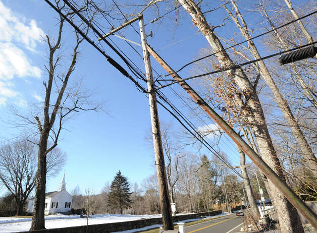 Power lines  in front of the Dingletown Community Church at 376 Stanwich Road, Greenwich, Thursday, Feb. 21, 2013. The town has asked Connecticut Light and Power to study burying power lines in four sections of town. The areas are a section of King Street between Sherwood Avenue and Cliffdale Road; Stanwich Road between East Putnam Avenue and the Merritt Parkway, downtown Greenwich and a section of Riverside that would include Eastern Middle and Riverside schools. Many residents of the town have pushed the concept of burying lines after a series of devastating storms has seen thousands of CL&P customers in Greenwich lose power for days at a time. Photo: Bob Luckey / Greenwich Time