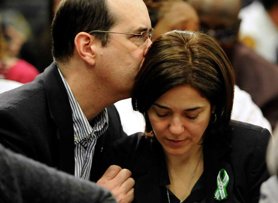 David and Francine Wheeler, parents of Sandy Hook Elementary School shooting victim Benjamin Wheeler, embraced during a gun violence conference in Danbury, Conn., Thursday. Photo: Jessica Hill, FRE / FR125654 AP
