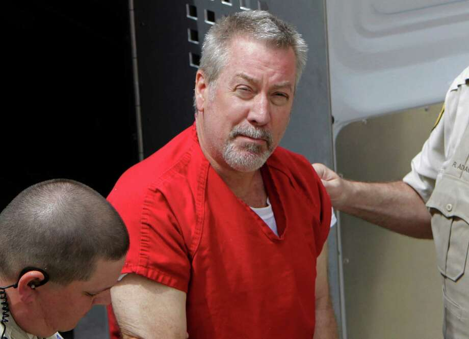 FILE - In this May 8, 2009 file photo, former Bolingbrook, Ill., police sergeant Drew Peterson arrives at the Will County Courthouse in Joliet, Ill., for his arraignment on charges of first-degree murder in the 2004 death of his third wife Kathleen Savio. On Thursday, Feb. 21, 2013, Will County Judge Edward Burmila refused to grant Peterson a new murder trial in the death of his third wife. The ruling came after Peterson's current legal team argued for a new trial on grounds his former lead attorney botched the case. After the ruling, the judge moved on to Peterson's sentencing hearing. (AP Photo/M. Spencer Green, File) Photo: M. Spencer Green