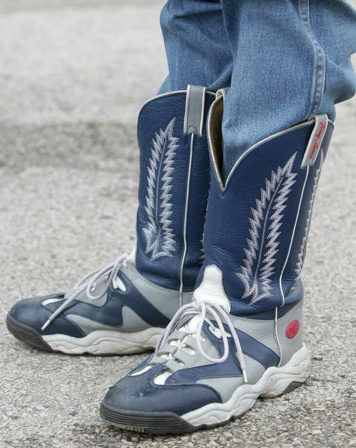 Houston Livestock Show and Rodeo BBQ Committee member Joe Tracy of Katy wears a pair of Tony Lama cowboy boot sneakers Thursday, Feb. 21, 2013, in Houston. The World's Championship Bar-B-Que contest kicks-off the Houston Livestock Show and Rodeo at Reliant Park. Photo: Melissa Phillip, Houston Chronicle / © 2013  Houston Chronicle