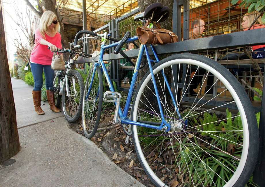 The proposal would give businesses incentives to provide parking for bicycles and in some cases require it. The measure would affect mainly bars and restaurants and is expected to go before City Council soon. Photo: J. Patric Schneider, Freelance / © 2013 Houston Chronicle