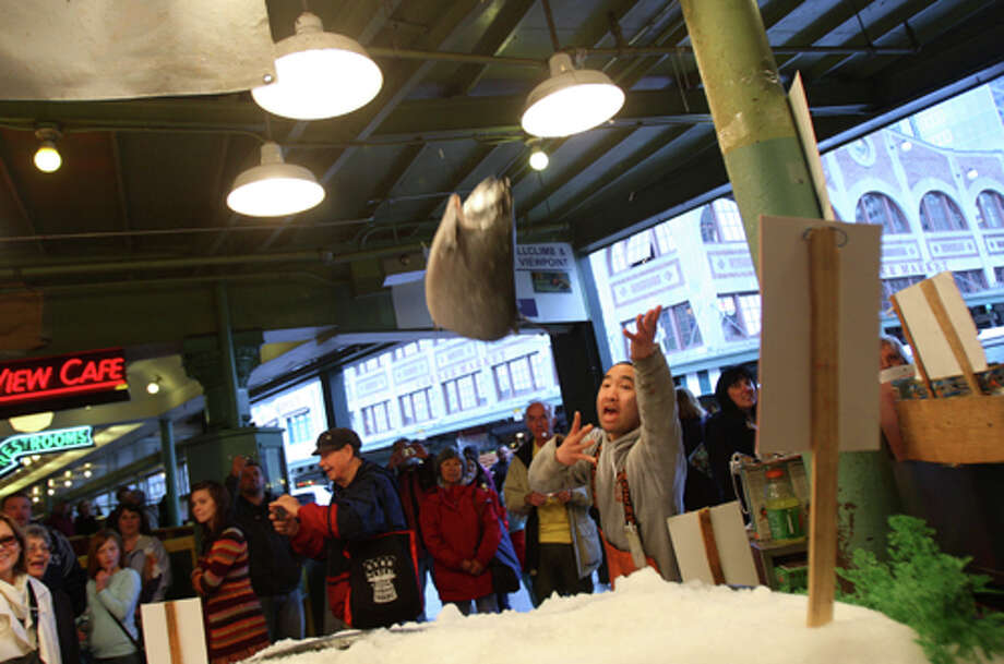 How did Seattle stack up? The study found that just 18 percent of fish tested here – 1 in 5 samples – was mislabeled. That tied with Boston for the lowest rate of fish deception in cities tested. (It's unknown if researchers tested fish from the Pike Place Market, pictured). Photo: Mike Kane, Seattle Post-Intelligencer / Seattle Post-Intelligencer
