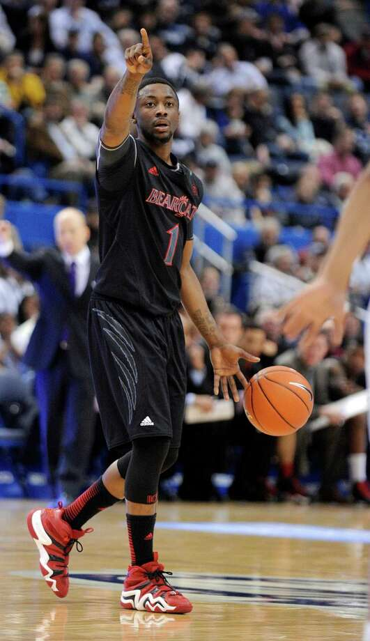 Cincinnati's Cashmere Wright signals to his team during the first half of an NCAA college basketball game against Connecticut in Hartford, Conn., Thursday, Feb. 21, 2013. (AP Photo/Fred Beckham) Photo: Fred Beckham, Associated Press / FR153656 AP