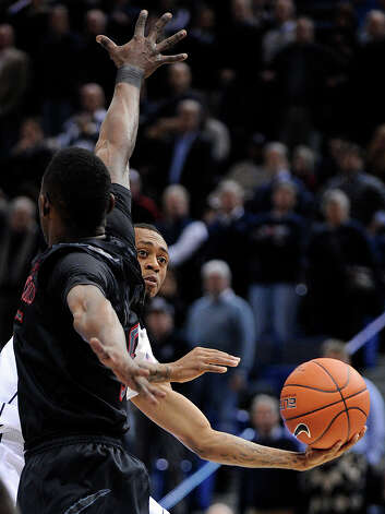 Connecticut's Ryan Boatright, right, drives past Cincinnati's Justin Jackson during the first half of an NCAA college basketball game in Hartford, Conn., Thursday, Feb. 21, 2013. (AP Photo/Fred Beckham) Photo: Fred Beckham, Associated Press / FR153656 AP