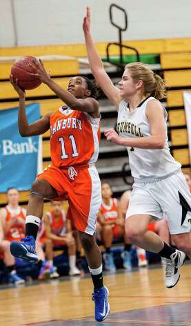 Trumbull high school's Alexa Pfohl tries to stop Danbury high school's Uniqua Tucker from going up for a basket in the 2012-2013 FCIAC girls basketball championship played at Fairfield Ludlowe high school, Fairfield, CT on Thursday February 21st, 2013. Photo: Mark Conrad / Connecticut Post Freelance