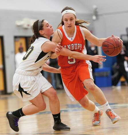 Danbury high school's Rachel Gartner drives past Trumbull high school'sLauren Hyde in the 2012-2013 FCIAC girls basketball championship played at Fairfield Ludlowe high school, Fairfield, CT on Thursday February 21st, 2013. Photo: Mark Conrad / Connecticut Post Freelance