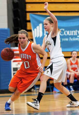 Danbury high school's Allie Smith tries to get by Trumbull high school's Amanda Pfohl in the 2012-2013 FCIAC girls basketball championship played at Fairfield Ludlowe high school, Fairfield, CT on Thursday February 21st, 2013. Photo: Mark Conrad / Connecticut Post Freelance