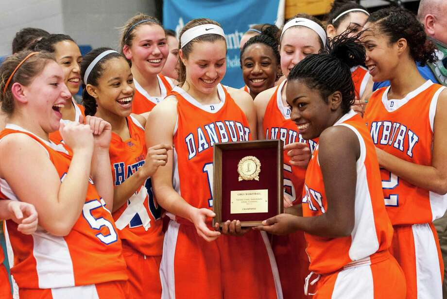 The Danbury high school girls basketball team hold up their FCIAC girls 2012-2013 FCIAC girls basketball championship trophy after defeating Trumbull high school at Fairfield Ludlowe high school, Fairfield, CT on Thursday February 21st, 2013. Photo: Mark Conrad / Connecticut Post Freelance