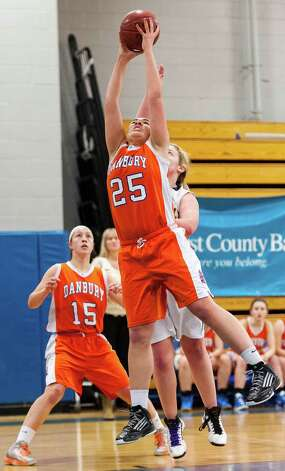 Danbury high school center Kayla Handberry pulls down a rebound in the 2012-2013 FCIAC girls basketball championship game against Trumbull high school played at Fairfield Ludlowe high school, Fairfield, CT on Thursday February 21st, 2013. Photo: Mark Conrad / Connecticut Post Freelance