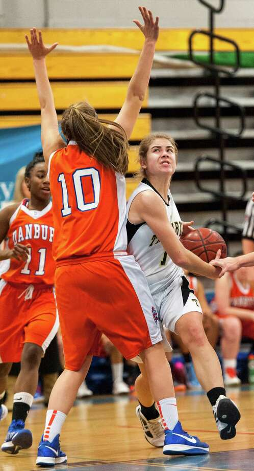Trumbull high school's Alexa Pfohl driving toward the basket in the 2012-2013 FCIAC girls basketball championship game against Danbury high school played at Fairfield Ludlowe high school, Fairfield, CT on Thursday February 21st, 2013. Photo: Mark Conrad / Connecticut Post Freelance