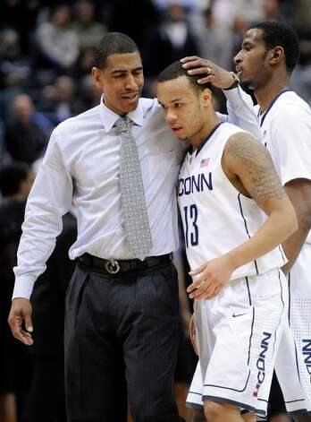 Connecticut coach Kevin Ollie speaks with Shabazz Napier late in overtime of Connecticut's 73-66 victory over Cincinnati in an NCAA college basketball game in Hartford, Conn., Thursday, Feb. 21, 2013. (AP Photo/Fred Beckham) Photo: Fred Beckham, Associated Press / FR153656 AP