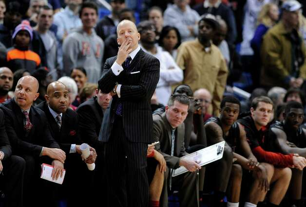 Cincinnati coach Mick Cronin watches action late in overtime of his team's 73-66 loss to Connecticut in an NCAA college basketball game in Hartford, Conn., Thursday, Feb. 21, 2013. (AP Photo/Fred Beckham) Photo: Fred Beckham, Associated Press / FR153656 AP