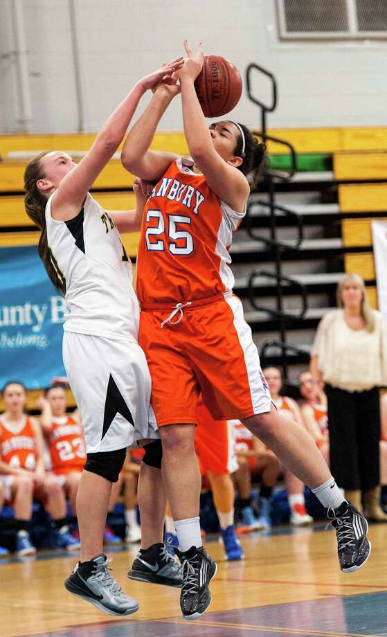 Trumbull high school's Katherine O'Leary and Danbury high school's Kayla Handberry fight for a rebound in the 2012-2013 FCIAC girls basketball championship game played at Fairfield Ludlowe high school, Fairfield, CT on Thursday February 21st, 2013. Photo: Mark Conrad / Connecticut Post Freelance