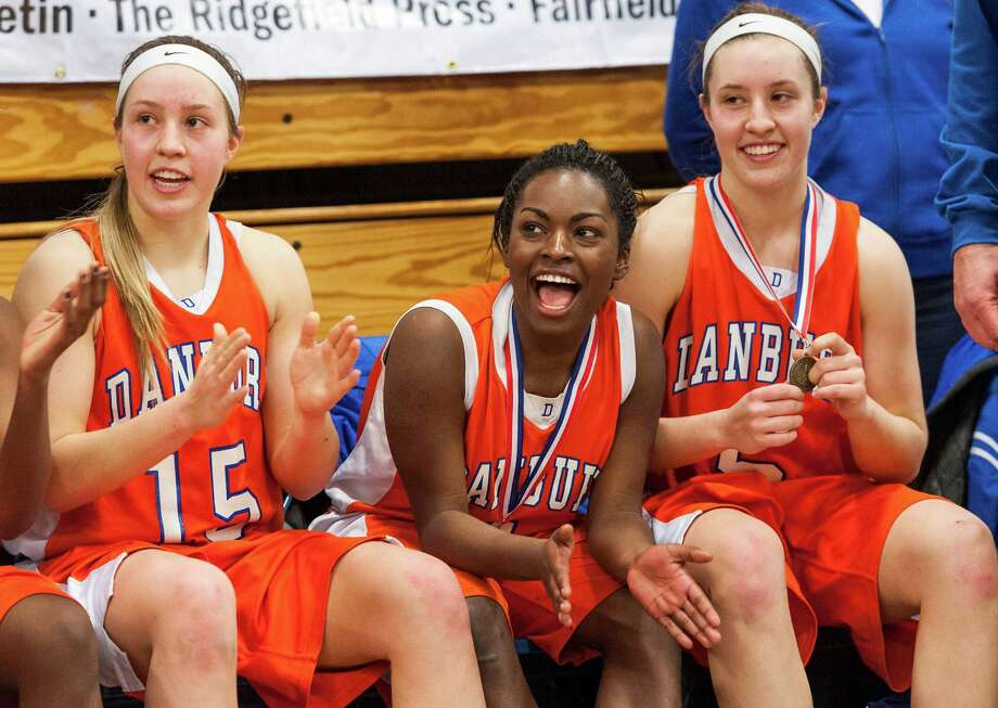 Danbury high school's Rebecca Gartner, Nahla Ward, and Rachel Gartner cheer on their teammates as they receive their FCIAC championship medals following the 2012-2013 FCIAC girls basketball championship game against Trumbull high school played at Fairfield Ludlowe high school, Fairfield, CT on Thursday February 21st, 2013. Photo: Mark Conrad / Connecticut Post Freelance