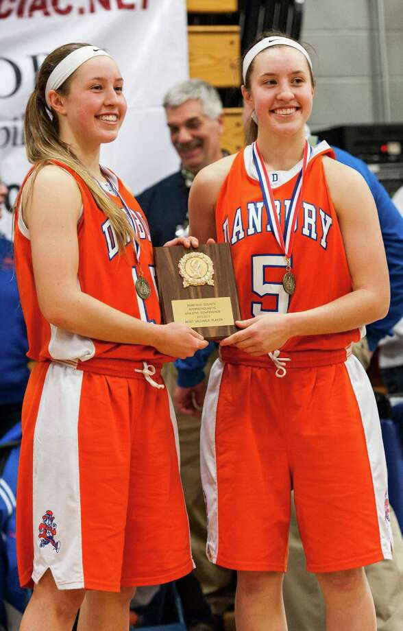 2012-2013 FCIAC girls basketball championship co-mvps Danbury high school's Rebecca Gartner  and Rachel Gartner during the post game ceremony following their game against Trumbull high school played at Fairfield Ludlowe high school, Fairfield, CT on Thursday February 21st, 2013. Photo: Mark Conrad / Connecticut Post Freelance