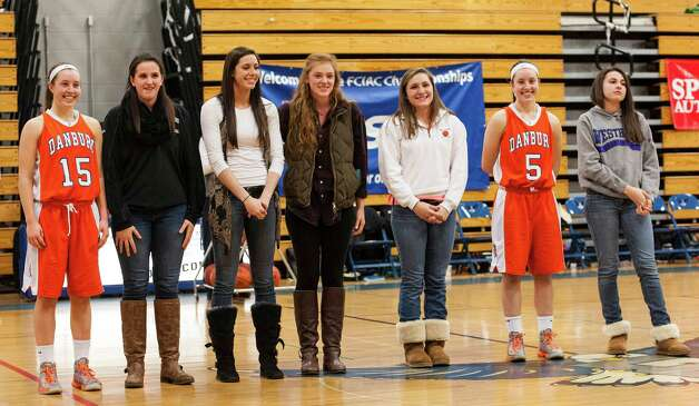 The all FCIAC girls basketball first team during the half time ceremony at the 2012-2013 FCIAC girls basketball championship game between Danbury high school and Trumbull high school played at Fairfield Ludlowe high school, Fairfield, CT on Thursday February 21st, 2013. Photo: Mark Conrad / Connecticut Post Freelance