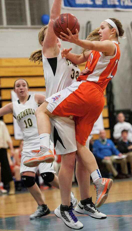 Danbury high school's Rebecca Gartner goes up for a basket in the 2012-2013 FCIAC girls basketball championship game against Trumbull high school played at Fairfield Ludlowe high school, Fairfield, CT on Thursday February 21st, 2013. Photo: Mark Conrad / Connecticut Post Freelance