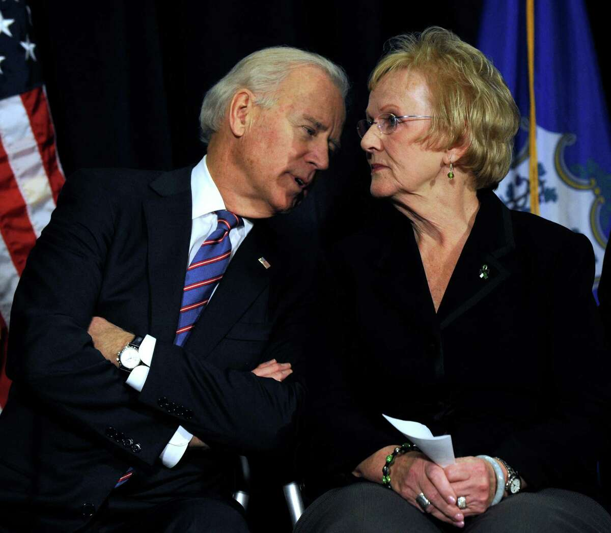 Vice President Joe Biden has a word with Newtown First Selectman Pat Llodra before speaking at a conference on gun violence at Western Connecticut State University in Danbury, Conn., Thursday, Feb. 21, 2013.