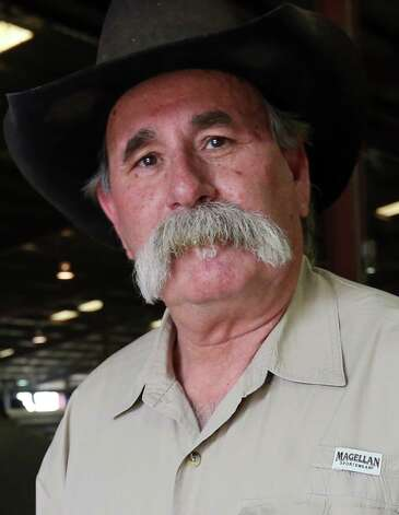 David Jalufka, 62, visits with the San Antonio Stock Show and Rodeo with his two grandsons, Thursday, Feb. 21, 2013. The former Karnes County sheriff spent three decades with the Department of Public Safety before being elected sheriff in 2004. Losing the last election, Jalufka has seen the tremendous change the county has undergone with the demands brought on by Eagle Ford Shale play. Photo: Jerry Lara, San Antonio Express-News / © 2013 San Antonio Express-News