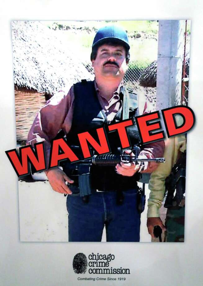 This poster displayed at a Chicago Crime Commission news conference Thursday, Feb. 14, 2013, in Chicago, shows Joaquin ``El Chapo'' Guzman, a drug kingpin in Mexico, who was deemed Chicago's  Public Enemy No. 1.  It is first time since prohibition, when the label was  created for Al Capone, that anyone else has been named Public Enemy No. 1.(AP Photo/M. Spencer Green) Photo: M. Spencer Green, Associated Press / AP