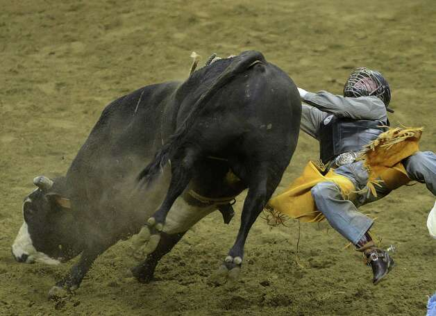 Trevor Kastner is tossed during the bull riding event at the San Antonio Stock Show & Rodeo in the AT&T Center on Thursday, Feb. 21, 2013. Photo: Billy Calzada, San Antonio Express-News / San Antonio Express-News
