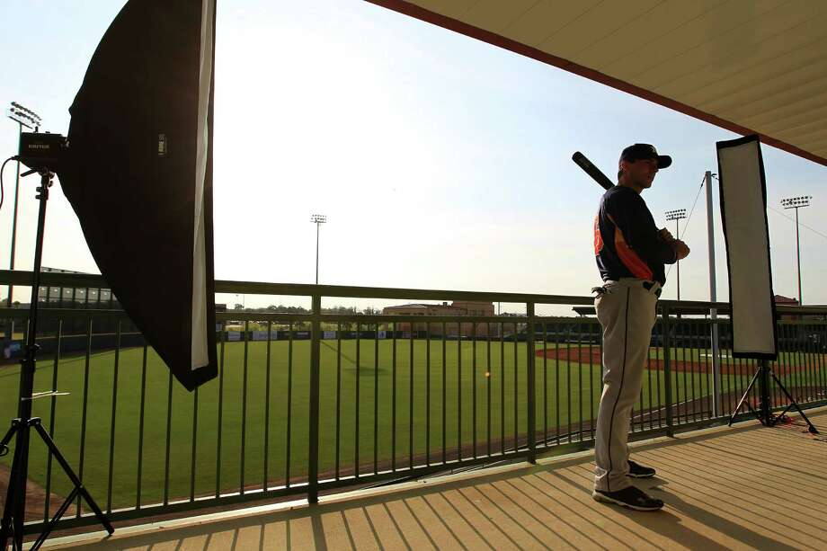 Astros outfielder Rick Ankiel has his picture taken by Topps before the start of Thursday's spring training workouts in Kissimmee, Fla. Photo: Karen Warren / Houston Chronicle