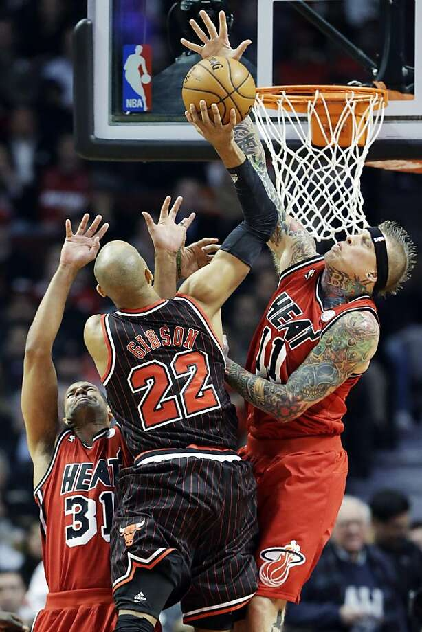 Miami's Chris Andersen rises to block a shot by Chicago's Taj Gibson during the Heat's ninth straight victory. Photo: Nam Y. Huh, Associated Press