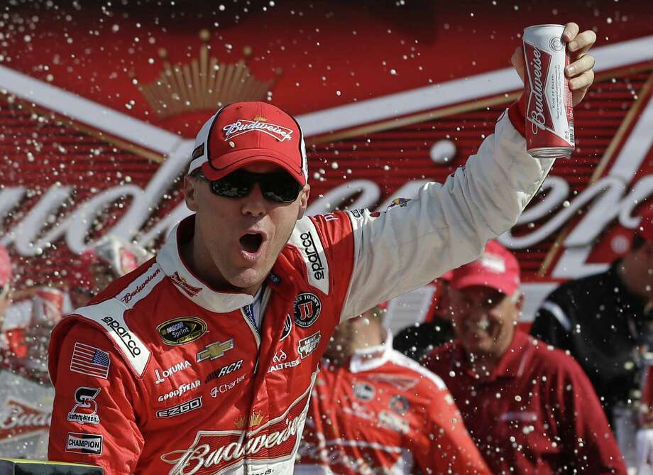 Kevin Harvick grabs a Bud after winning the first of two 150-mile qualifying races for the Daytona 500. Kyle Busch won the second race Thursday, and Danica Patrick retained the pole. Photo: John Raoux / Associated Press