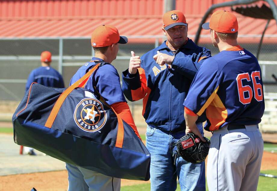 Talking baseball with Astros prospects such as catcher Ryan McCurdy, left, and pitcher Kevin Chapman proved a natural fit this week for Roger Clemens. The former pitching great was anything but reclusive during his four-day stint as a special instructor. Photo: Karen Warren, Staff / © 2013 Houston Chronicle