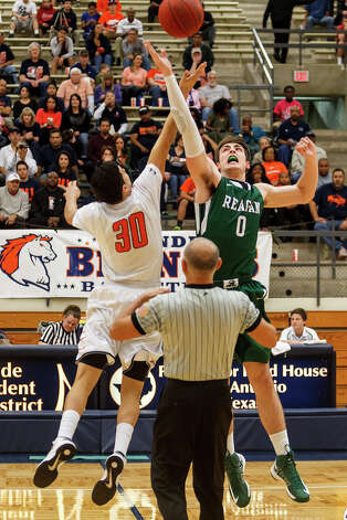 Brandeis's Matt Kallead (left) and Reagan's D.J. MacLeay battle for the tip-off at the start of their Class 5A boys basketball second round game at Paul Taylor Field House on Thursday, Feb. 21, 2013.  Brandeis won the game 64-58.   MARVIN PFEIFFER/ mpfeiffer@express-news.net Photo: MARVIN PFEIFFER, Express-News / Express-News 2013