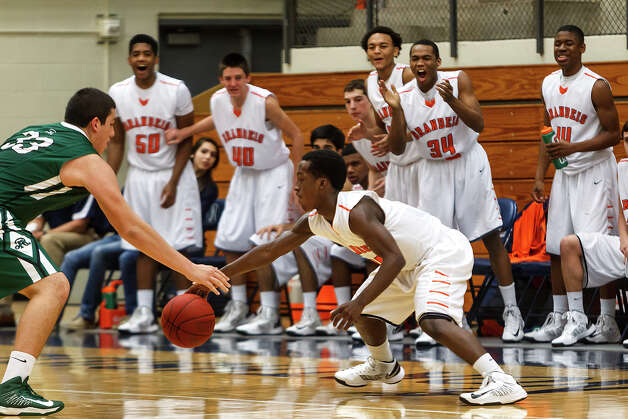 The Brandeis bench reacts as Chris Starkes (right) stretches to keep the ball from Reagan's Jordan Alvarado during the fourth quarter of their Class 5A boys basketball second round game at Paul Taylor Field House on Thursday, Feb. 21, 2013.  Brandeis won the game 64-58.   MARVIN PFEIFFER/ mpfeiffer@express-news.net Photo: MARVIN PFEIFFER, Express-News / Express-News 2013