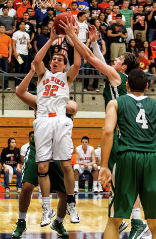 Brandeis's Jared Thompson (left) battles Reagan's D.J. MacLeay for a rebound during the second half of their Class 5A boys basketball second round game at Paul Taylor Field House on Thursday, Feb. 21, 2013.  Brandeis won the game 64-58.   MARVIN PFEIFFER/ mpfeiffer@express-news.net Photo: MARVIN PFEIFFER, Express-News / Express-News 2013