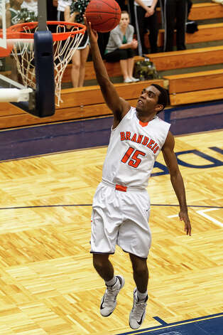 Brandeis's Justin Graham goes up for an uncontested layup during the first half of their Class 5A boys basketball second round game with Reagan at Paul Taylor Field House on Thursday, Feb. 21, 2013.  Graham led the Broncos with 17 points as they advanced to the next round with a 64-58 victory over the Rattlers.  MARVIN PFEIFFER/ mpfeiffer@express-news.net Photo: MARVIN PFEIFFER, Express-News / Express-News 2013