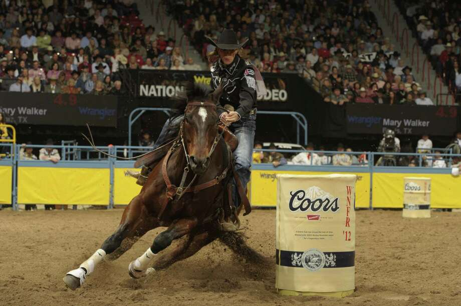 Mary Walker — who won the world barrel racing title at age 53 last December, becoming the second-oldest woman to accomplish the feat — endured a difficult time in 2011, when her only child died of injuries suffered in an auto accident, and six weeks later she shattered her hip and fractured two vertebrae and two toes as her horse fell. Photo: Courtesy Photo