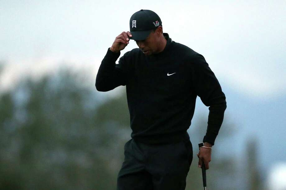 MARANA, AZ - FEBRUARY 21:  Tiger Woods reacts after he lost his match in 17 holes to Charles Howell III during the first round of the World Golf Championships - Accenture Match Play at the Golf Club at Dove Mountain on February 21, 2013 in Marana, Arizona. Round one play was suspended on February 20 due to inclimate weather and is scheduled to be continued today. Howeel III won 2 and 1 in 17 holes. (Photo by Jed Jacobsohn/Getty Images) Photo: Jed Jacobsohn