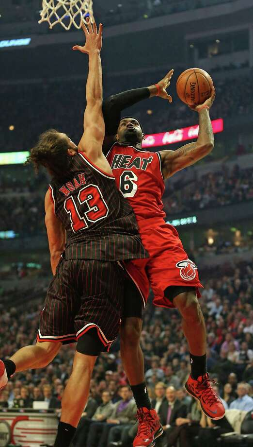 CHICAGO, IL - FEBRUARY 21: LeBron James #6 of the Miami Heat goes up for a shot against Joakim Noah #13 of the Chicago Bulls at the United Center on February 21, 2013 in Chicago, Illinois. NOTE TO USER: User expressly acknowledges and agrees that, by downloading and or using this photograph, User is consenting to the terms and conditions of the Getty Images License Agreement. (Photo by Jonathan Daniel/Getty Images) Photo: Jonathan Daniel