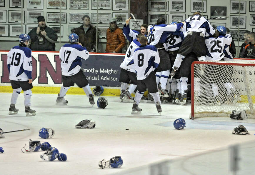 The Saratoga hockey team celebrates after defeating Shenendehowa in the section II division l hockey