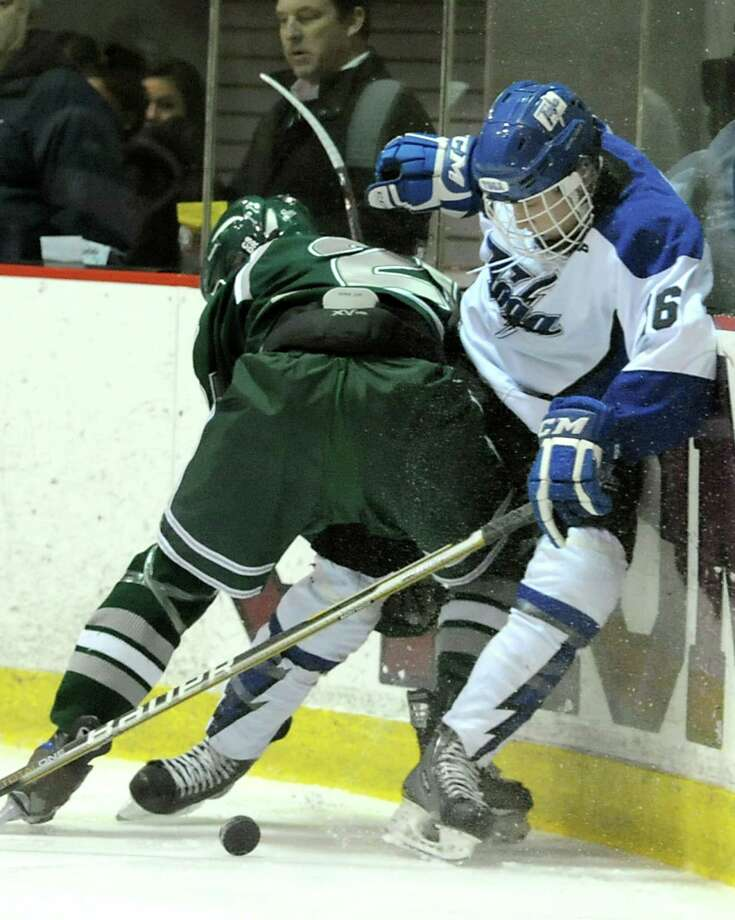 From left, Shenendehowa's Ryan Mortka battles for the puck with Saratoga's Matt Flynn during the section II division I hockey championship game at Union College on Thursday Feb. 21, 2013 in Schenectady, N.Y.  (Lori Van Buren / Times Union) Photo: Lori Van Buren