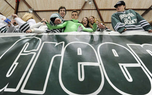 Shenendehowa fans peer over a school sign during the section II division I hockey championship game against Saratoga at Union College on Thursday Feb. 21, 2013 in Schenectady, N.Y.  (Lori Van Buren / Times Union) Photo: Lori Van Buren