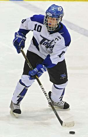 Saratoga's Brendon Wormley takes the puck down the ice during the section II division I hockey championship game against Shenendehowa at Union College on Thursday Feb. 21, 2013 in Schenectady, N.Y.  Tyler was one of two players voted player of the year in the Capital District. (Lori Van Buren / Times Union) Photo: Lori Van Buren