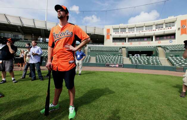 Former Olympic swimmer Michael Phelps waits to hit in the batting cage during a Baltimore Orioles baseball spring training workout Thursday, Feb. 21, 2013, in Sarasota, Fla.  Phelps, a native of Baltimore who was in the area filming his Golf Channel show The Haney Project, took batting practice with the team. (AP Photo/Charlie Neibergall) Photo: Charlie Neibergall
