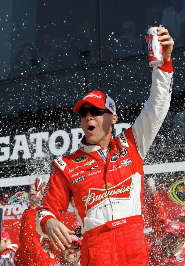 Driver Kevin Harvick celebrates in victory lane after winning the first of two 150-mile qualifying races for the NASCAR Daytona 500 auto race at Daytona International Speedway, Thursday, Feb. 21, 2013, in Daytona Beach, Fla. (AP Photo/Terry Renna) Photo: Terry Renna
