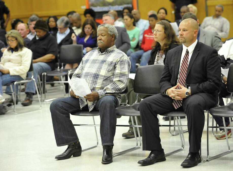 The next Central Medical Magnet High School boys football coach, Toby Foreman, right, sits in the front row during Thursday nights BISD board meeting. Foreman is the former offensive coordinator and track and field coach at West Orange-Stark High School. He also was an assistant football coach at both Texas High and LaMarque High Schools.   Dave Ryan/The Enterprise