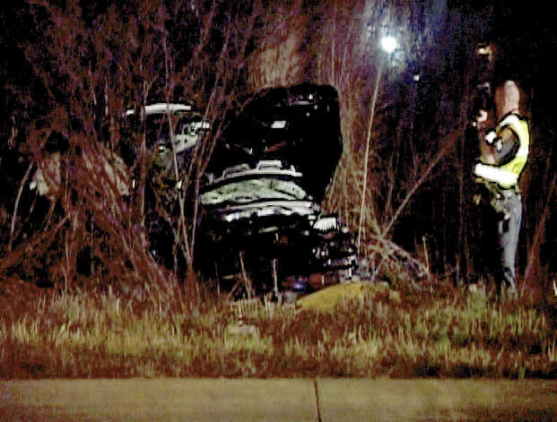 A police officer investigates the site of a wreck in the 11500 block of Crosswinds Way that killed Andrea Reyna. Late for her curfew, the girl was not wearing a seatbelt as she rushed toward home and lost control of her new car, a 2008 Hyundai Accent. Photo: Henry Valadez, Jr. / For The San Antonio Express-News